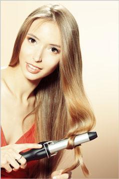 blonde girl curling hair